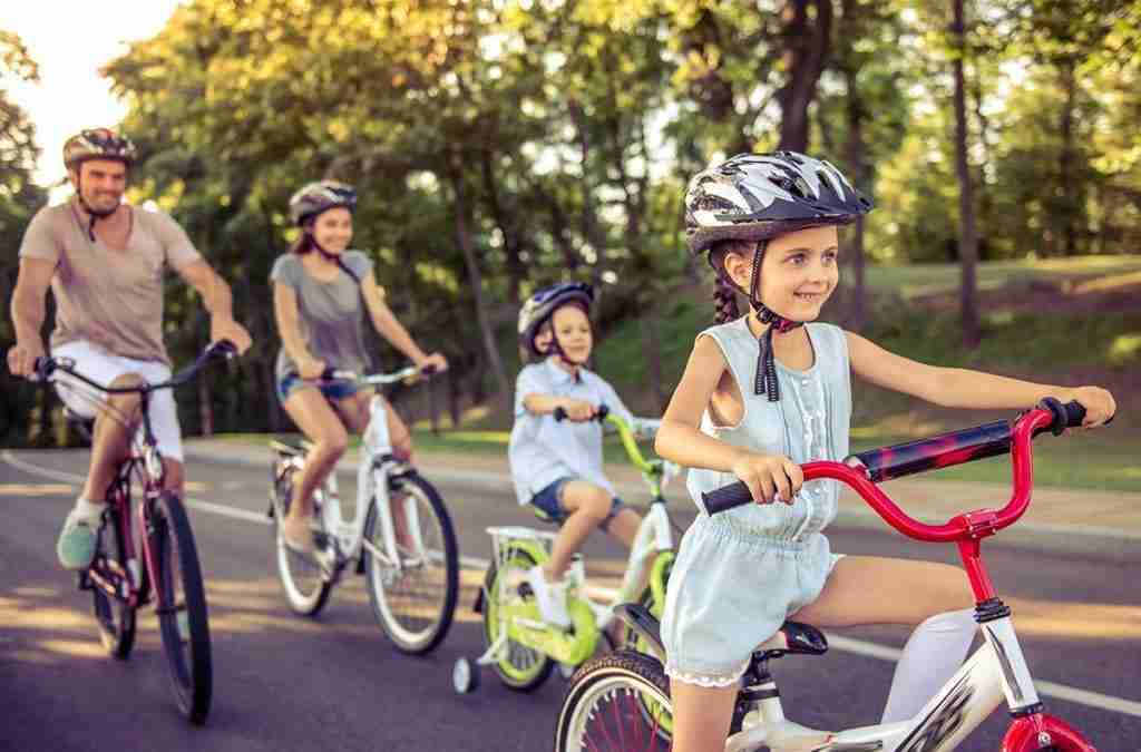 child-safety-family-with-two-children-riding-bikes