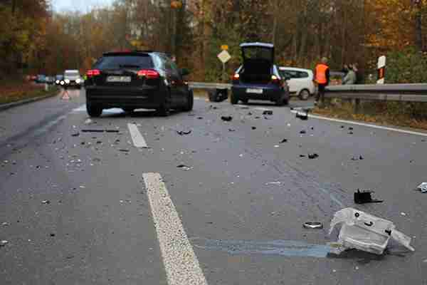 Personal-injury-attorney-faq-site-of-three-car-accident-with-debris-on-road